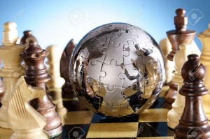 2379592-Globe-puzzle-and-chess-pieces-Stock-Photo-chess